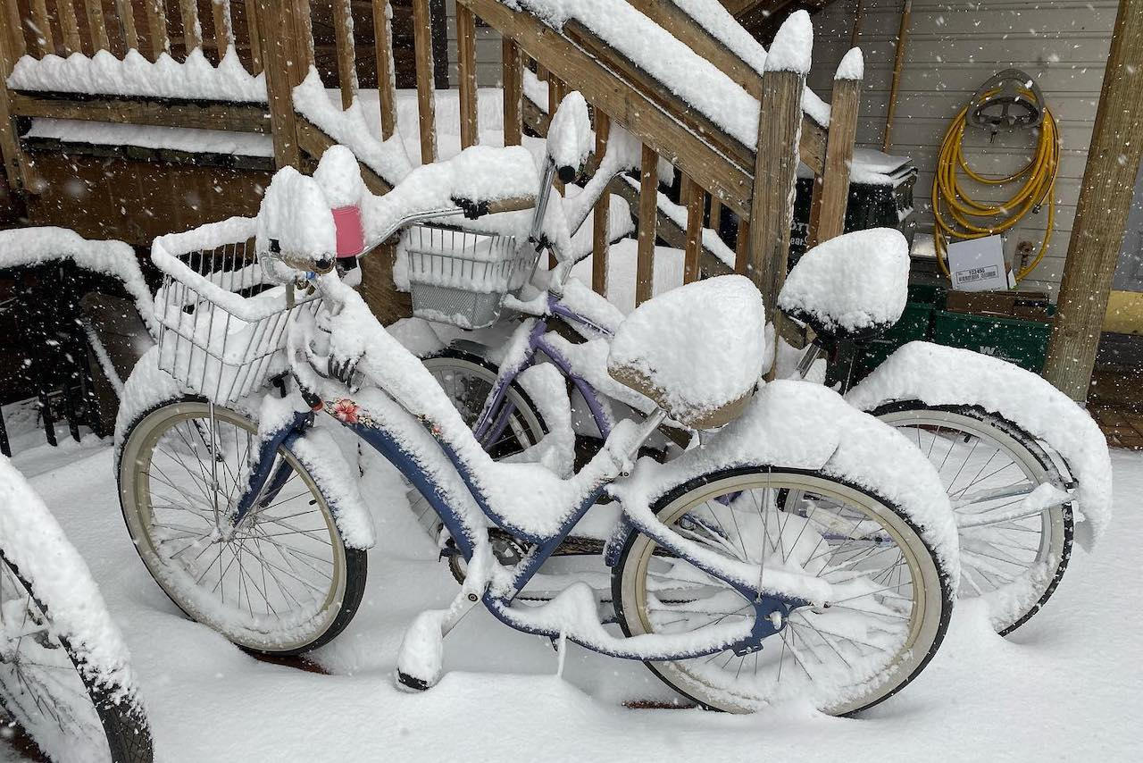 Townie bikes covered in snow.